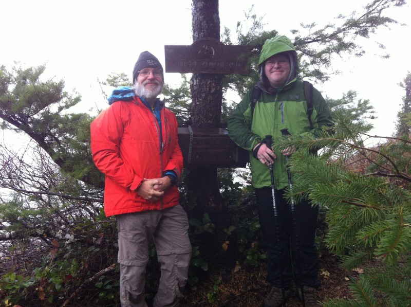 At the Kings Mountain summit, by the signpost and the summit register box