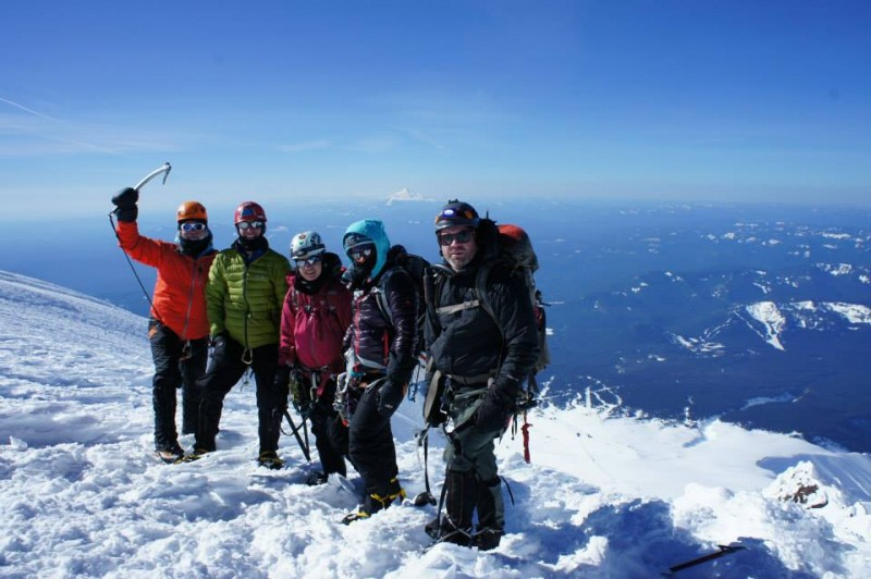 At the summit, with Mt. Jefferson in the distance: me, Dave, Amy, Lisa, and Tommy